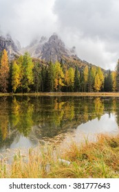 Lago Antorno with mountain reflected in the lake and trees in autumn colours