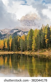 Lago Antorno with Tre Cime di Lavaredo reflected in the lake and trees in autumn colours