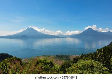 Lago Atitlan along with 2 volcanoes, Panajachel, Guatemala.