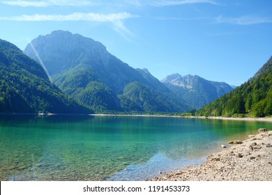 Lago del Predil (Predil Lake), small mountain lake with turquoise water in Julian Alps, Tarvisio with mountains in background, Italy, Europe