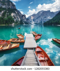 Lago di Braers lake, Dolomite Alps, Italy. Boats on the lake. Landscape in the Dolomite Alps, Italy. Pragser Wildsee - Image