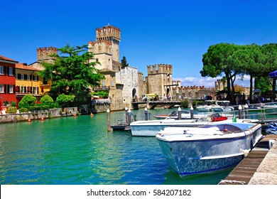 Lago di Garda - pictorial view with Rocca Scaligera in Sirmione. Italy