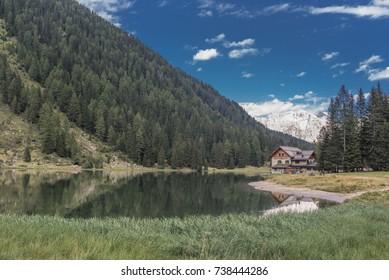 Lago di Nambino (lake), a uniquely beautiful and charming small lake, located in the heart of Adamello-Brenta Natural park, above Madonna di Campiglio village, Brenta Dolomites, Trentino, Italy