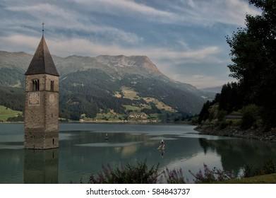 Lago di Resia (Curon Venosta) Trentino Alto Adige, Italia with floers Reschensee (Curon Venosta) Trentino Alto Adige, Italy