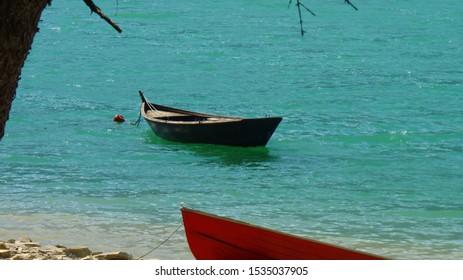 Lago di Santa Croce, Italy - boat on calm water