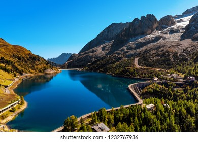 Lago Fedaia (Fedaia lake), an artificial lake and a dam near Canazei city, located at the foot of Marmolada massif, as seen from Viel del Pan refuge, Dolomites, Trentino, province of Belluno, Italy
