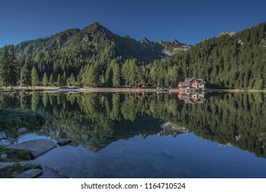 Lago (lake) di Nambino, located in the heart of Adamello-Brenta Natural park, a uniquely picturesque & tranquil small lake, close to Madonna di Campiglio village, Brenta Dolomites, Tentino, Italy