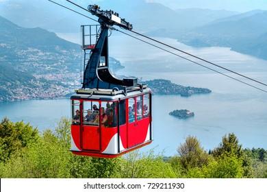 Lago Maggiore (Lake Maggiore) cableway mountain cable car cabin go downhill from the mount Mottarone top (Stresa, Italy, May 22 2017)