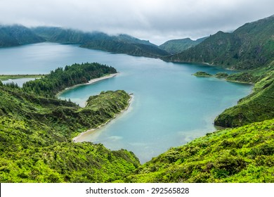 Lagoa do Fogo, a volcanic lake in Sao Miguel, Azores under the dramatic clouds