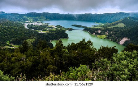 Lagoa Verde and Lagoa Azul, two adjacent lakes in a volcanic crater called Sete Cidades. In Sao Miguel island Portuguese Azores archipelago. Europe