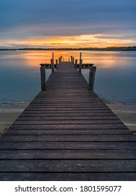 Lagoon landscape at dawn with wooden jetty