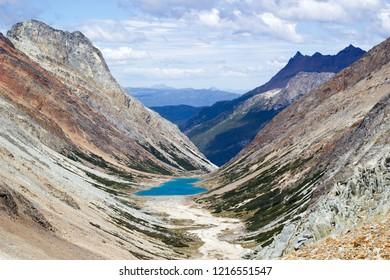 lagoon and mountains landscape in Valdivieso mountain range, Ushuaia, Tierra del Fuego island, Patagonia Argentina, South America
