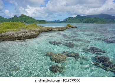 The lagoon with a rocky islet of the island of Huahine near Maroe bay, Pacific ocean, French Polynesia