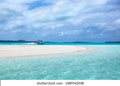 The lagoon tour through paradise lagoon on the small ship. Blue lagoon cruises in pacific ocean, Cook Islands, Aitutaki. Clouds versus lagoon.
