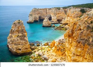 Lagos, Algarve / Portugal - 06/04/2018: Marinha Beach, a mediterranean beach with limestone rock coastal cliffs - Portugal South Coast