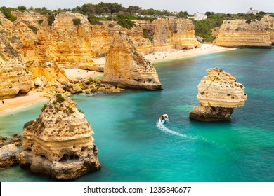 Lagos, Algarve / Portugal - 06/04/2018: Marinha Beach, a mediterranean beach with limestone rock coastal cliffs - Portugal South Coast
