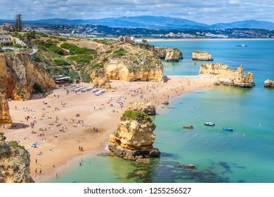 Lagos, Algarve / Portugal - 06/04/2018:Dona Ana Beach, with limestone cliffs and pinnacles tipical of the Algarve coast, South Portugal