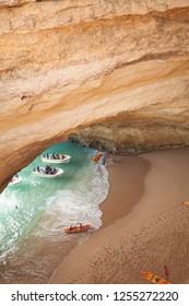 Lagos, Algarve / Portugal - 06/04/2018:motor boats on Benagil Cave, a coastal sandstone cave