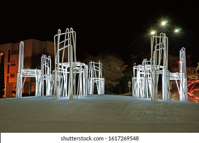 Lagos, The Algarve, Portugal, 2nd January 2020, light trails at night around chairs created and positioned on a roundabout in the town centre, to symbolise harmony, communication, democracy and peace.