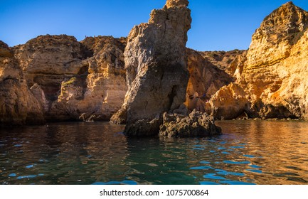Lagos Caves and Seashore with its Esmerald Water. Exposure done in a boat tour in the Lagos seashore, Algarve, Portugal