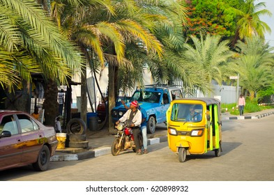 LAGOS - MAY 20: Tuk tuk drivers transport their passengers around the   port city of Lagos on May 20, 2016. Lagos port is responsible for   processing 80% of imports into Nigeria.