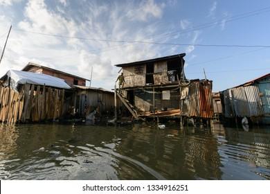 Lagos, Nigeria - 06/09/2014: A man leaves his house in Makoko floating slum.