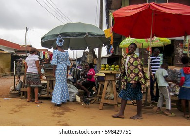 LAGOS, NIGERIA - AUGUST 10, 2012: People selling different goods in the street in the city of Lagos, the largest city in Nigeria and the African continent