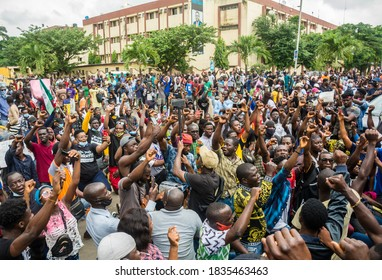 LAGOS, NIGERIA- OCTOBER 16, 2020: A crowd of Nigerian youths kneeling to protest against police brutality at an anti sars rally in Lagos, Nigeria