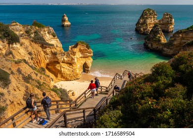 Lagos, Portugal - 6 March 2020: People going to Praia do Camilo Beach