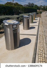 Lagos, Portugal - april,14, 2019: line of fixed, elegant, metal and odorless recycling containers