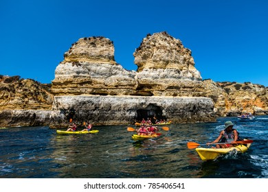 Lagos, Portugal, August 18, 2017: Kayak boats exploring the Ponta da Piedade rock formations near Lagos, Portugal