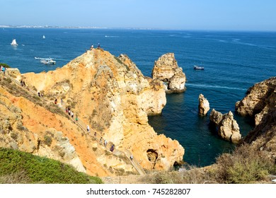LAGOS, PORTUGAL - August, 23, 2017: A view of the beautiful rock formations at Praia do Camilo in Lagos, Portugal.