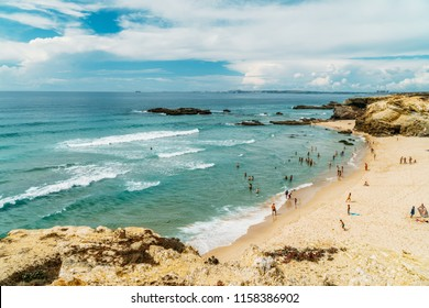 LAGOS, PORTUGAL - AUGUST 28, 2017: Tourists Having Fun In Water, Relaxing And Sunbathing In Lagos City On Beach At The  Ocean Of Portugal