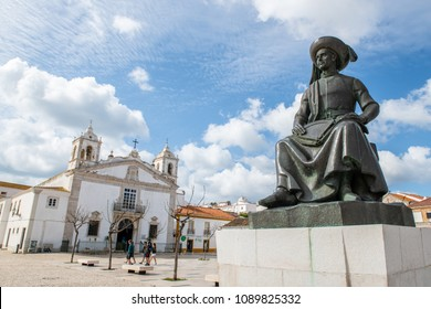 LAGOS, PORTUGAL - CIRCA MAY 2018: Statue of Infante Dom Henrique (Prince Henry) in the town square with town buildings to the rear, Lagos, Algarve, Portugal.