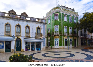 LAGOS, PORTUGAL - JAN 28, 2018 : Typical residential house coated with tiles at Luis de Camoes traditional cobbled square in ancient town of Lagos, Algarve Region, Portugal.
