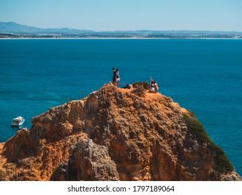 LAGOS, PORTUGAL - Jul 28, 2020: Ponta da Piedade near Lagos in Algarve, Portugal. Cliff rocks and tourist boat on sea at Ponta da Piedade, Algarve region, Portugal. Ponta da Piedade