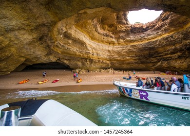 LAGOS, PORTUGAL - July 2019: People on the boat at Binagil grotto, Algarve, Portugal
