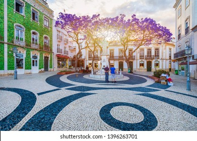 Lagos, Portugal - June 10, 2018: Street in the old town in the center of Lagos, Algarve region, Portugal. Narrow street in Lagos, Algarve, Portugal. Streets in the historic old town of Lagos, Algarve