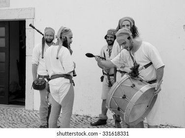 LAGOS, PORTUGAL - MAY 3, 2015: Five musicians in medieval costumes making a rehearsal before their performance at local medieval fair.