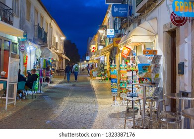 LAGOS, PORTUGAL - OCTOBER 29, 2018: People walking and sitting in a street restaurant at Old Town of Lagos, Portugal. Lagos - famous tourist destination in Portugal