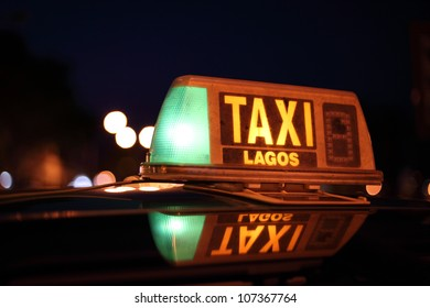 Lagos taxi sign illuminated at night, Algarve Portugal