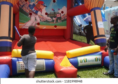 Lagos/Nigeria-April 15th, 2016: A baseball theme inflatable game played by children at a school carnival organised by the Parent Teacher Association (PTO). Inflatable theme games is popular in Africa.