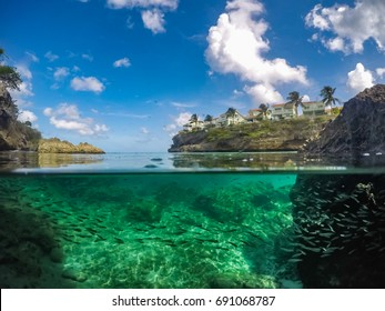 Lagun - half and half views underwater on the Caribbean of Curacao