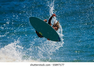 LAGUNA BEACH, CA-June 19:  Surfer skims in the 34th Annual Victoria Skimboards World Championship in Laguna Beach, CA. Competition was held on June 19 & 20, 2010 and sponsored by SkimChicks.