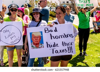 Laguna Beach, California - April 15, 2017. Hundreds gather in Laguna Beach California to demand that Donald Trump release his taxes.
