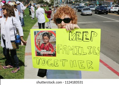 LAGUNA BEACH, CALIFORNIA - June 30, 2018: Keeping Families Together. People hold signs, chant slogans, in protest to stop the administration from separating families who cross the boarder illegally.
