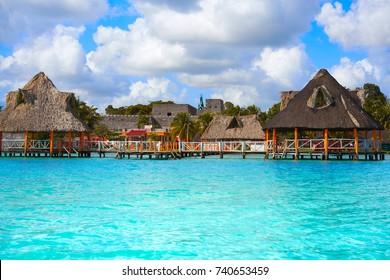 Laguna de Bacalar Lagoon palapas in Mayan Mexico at Quintana roo
