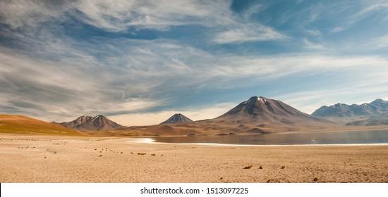 Laguna Miscanti and Laguna Miniquez in Atacama Desert. Salt lagunas and volcanos southern from San Pedro de Atacama. Stunning scenery in morning sunlight at Atacama desert, Chile, South America