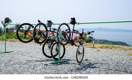 Laguna, Philippines - March 13, 2019: Some bicycles for rent hanging on a bicycle rack in Laguna, Philippines.