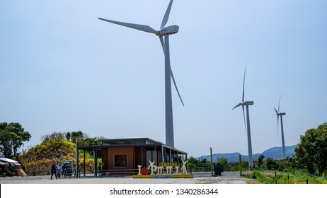 Laguna, Philippines - March 13, 2019: View on a hot summer windmill farm in Pililla, Rizal, Philippines.